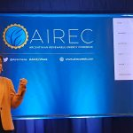 Doris Capurro speaking at AIREC conference.