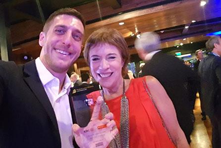 Doris Capurro & Daniel Hanna, receiving the award from Bonds and Loans.